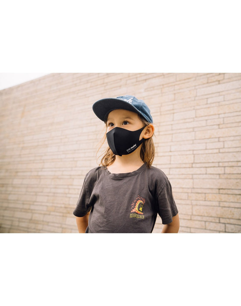 Kid wearing black colour mask