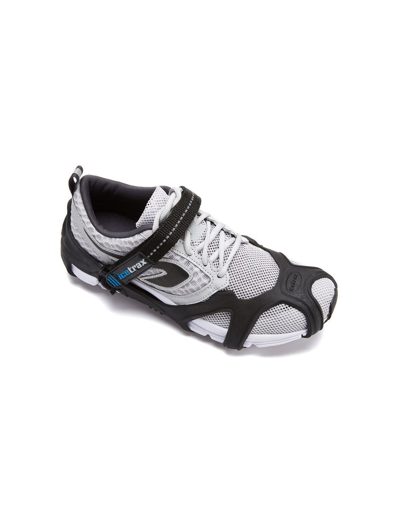 Icetrax V3 tungsten ice cleats with velcro straps on white shoes top view