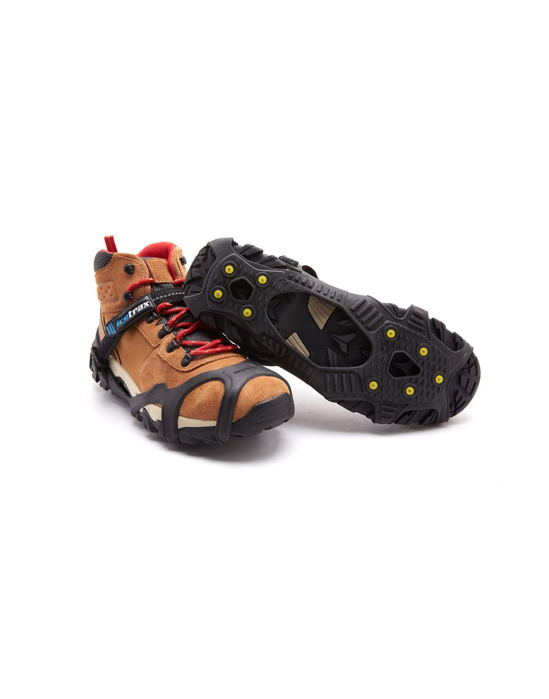 Icetrax V3 tungsten ice cleats with velcro straps on brown shoes