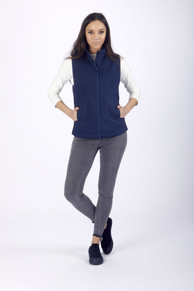Women wearing pacsafe transit women's insulated vest blue zipped front view