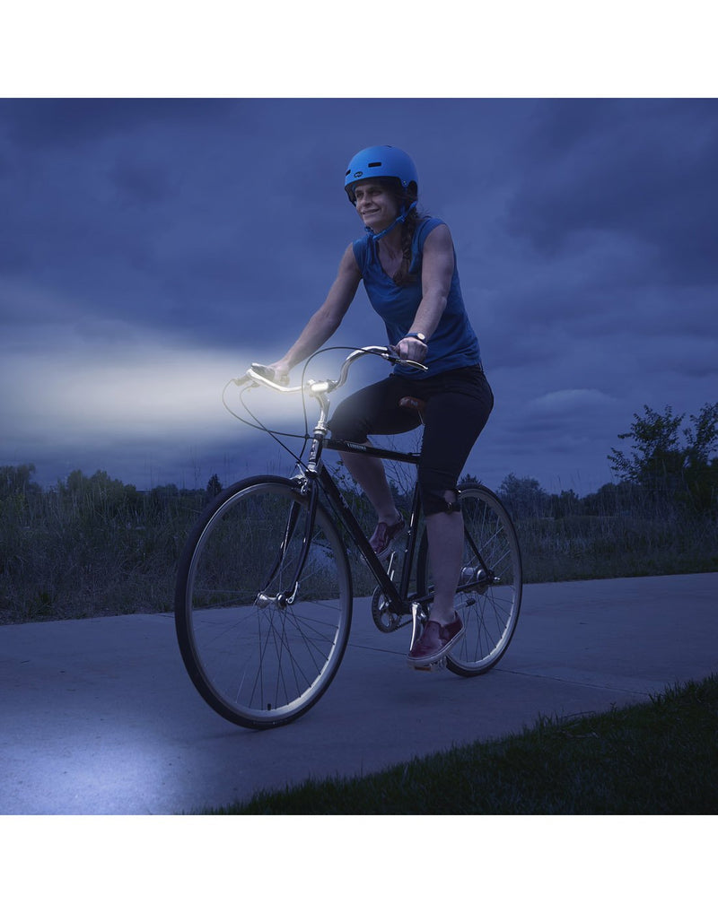 Girl using radiant® 50 bike light white LED at night