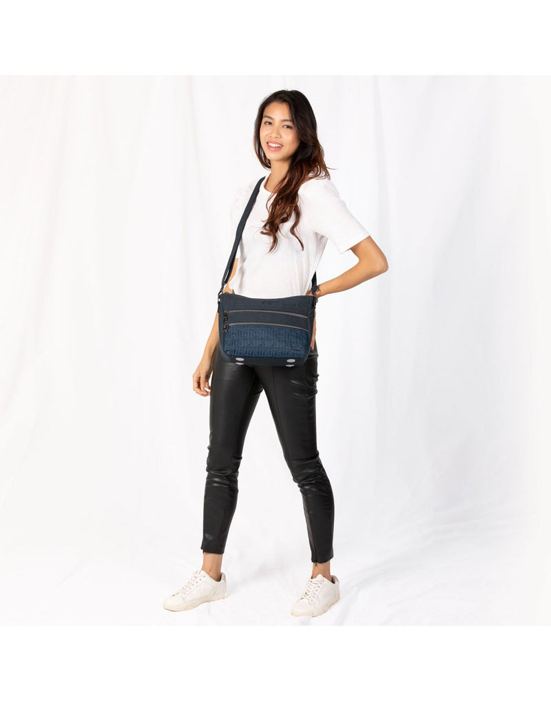 Women using lug slider navy blue colour crossbody purse