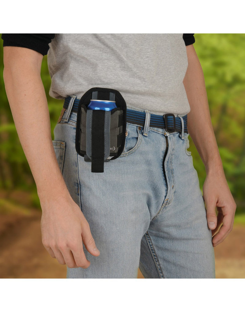 Man using Nite ize traveler™ drink holster with can attached to belt