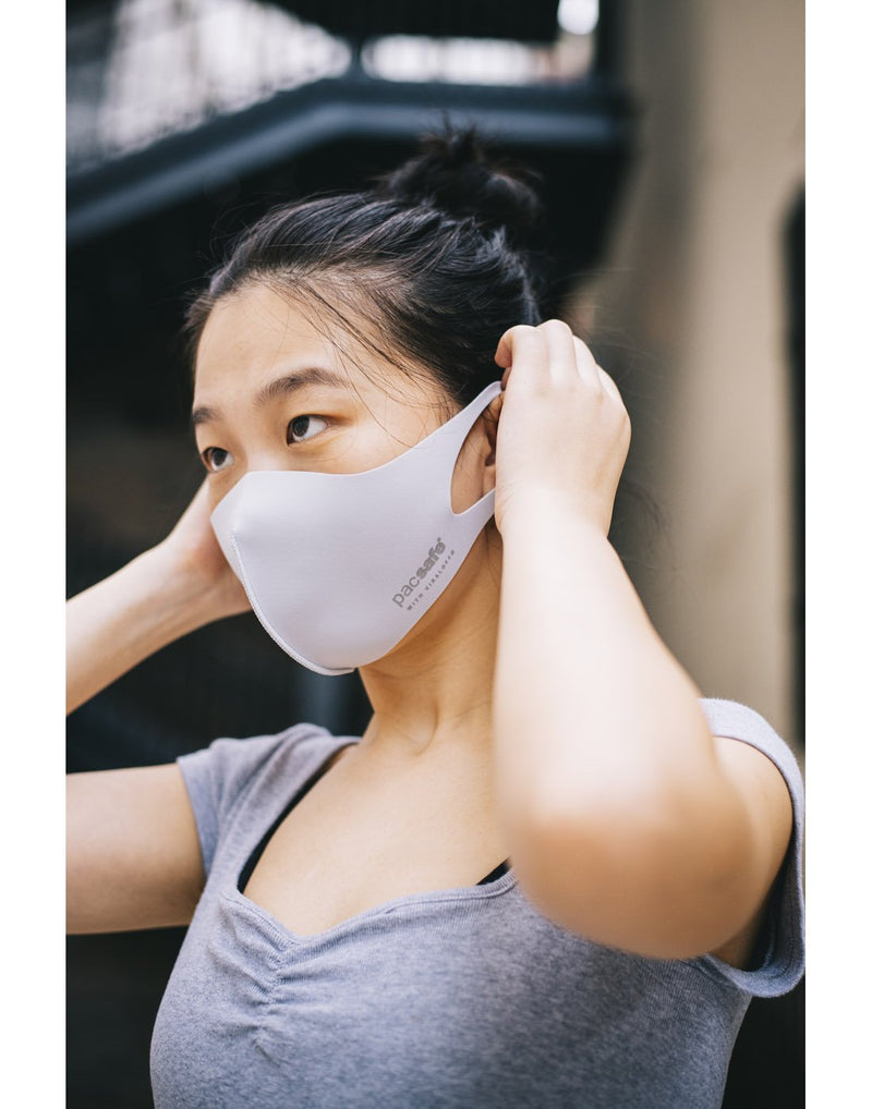 Girl wearing alo grey colour mask