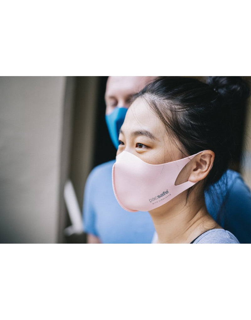 Girl wearing pink colour mask