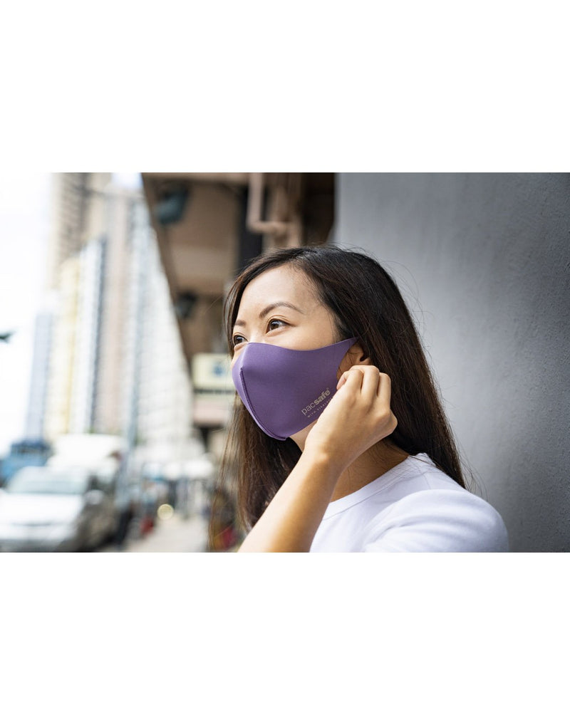 Girl wearing lilac colour mask