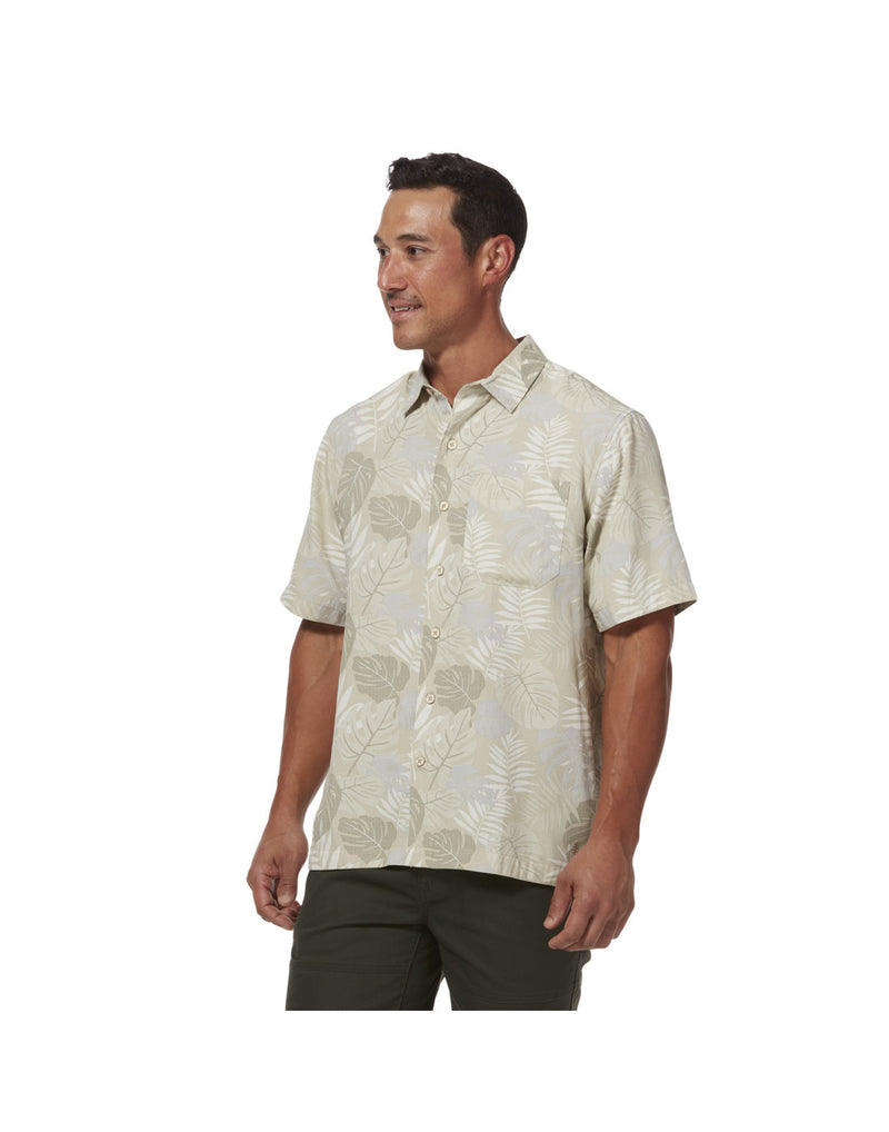 Model wearing Royal Robbins Men's Comino Leaf Short Sleeve Shirt - sand print