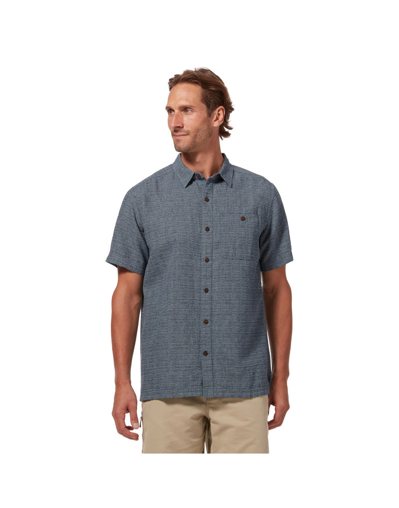 Model wearing Royal Robbins Men's Salton City Short Sleeve Shirt - collins blue