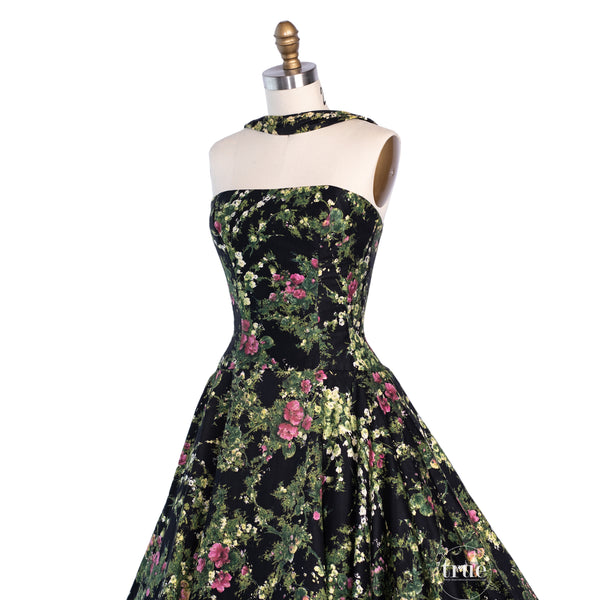 vintage 1950's dress ...extraordinary designer LUIS ESTÉVEZ vibrant floral over black polished cotton reverse halter choker neck dress with FULL CIRCLE skirt