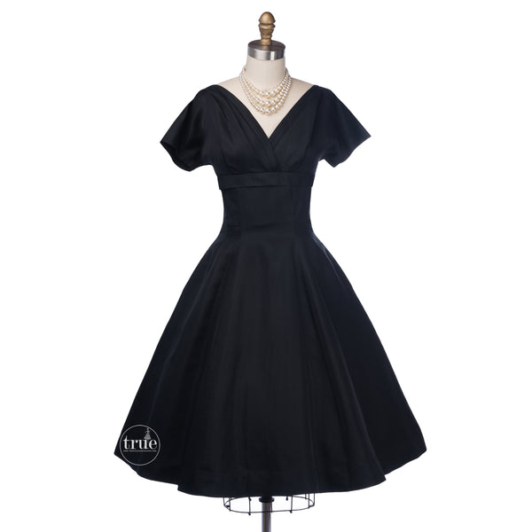 vintage 1950's dress ...simple elegance Madeleine Fauth black full skirt dress with streaming bow