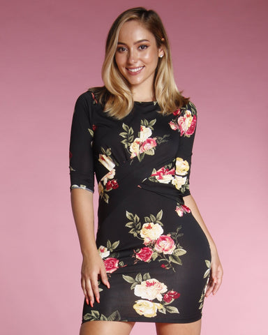 MID LENGTH SLEEVE FLORAL PRINT DRESS WITH A CREW NECKLINE AND WRAP DETAILING