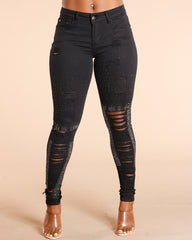 Black All Over Rips And Studs Jeans