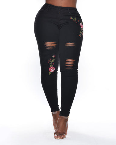 Skinny Rips And Roses Jeans