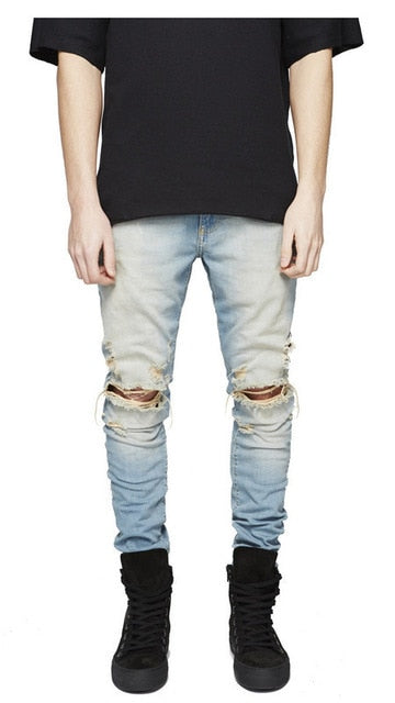 Distressed skinny ripped jeans