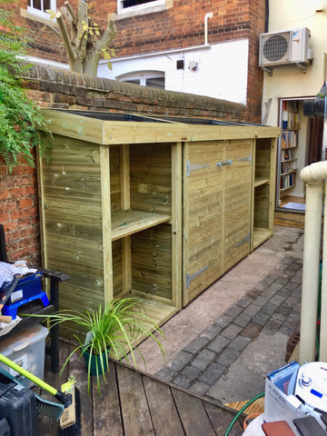 Garden tool storage shed with bin, recycling and log storage. All with living green roof planter to house succulents