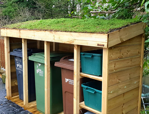 Triple wheelie bin and recycling storage unit.  Green roof planter filled with sedum matting