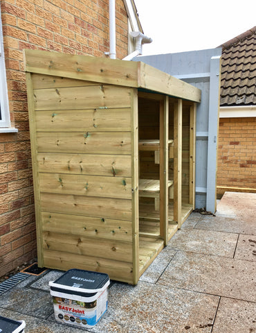 Green roof storage for two wheelie bins and recycling boxes