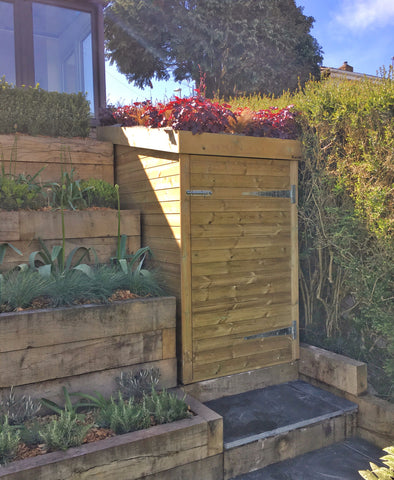 Custom made storage shed in Portishead with living green roof filled with heucheras and grasses