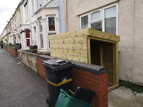 Open bike shed shelter with green roof planting area, for a small garden at the front of this house in Bristol