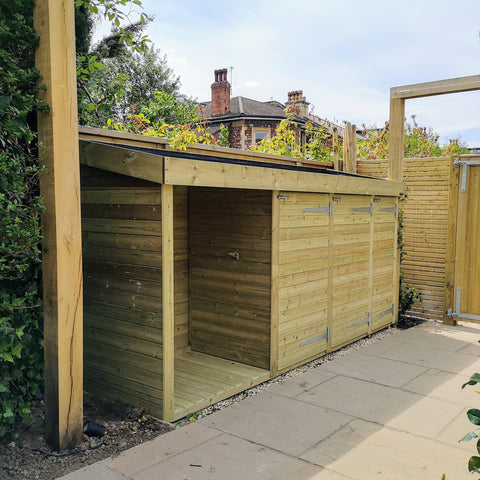 Wheelie bin, recycling and log storage unit with sedum roof in Bristol
