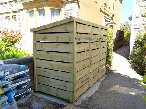 Bespoke storage for three wheelie bins, in a Victorian front garden in Bristol. Felt roof