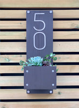 Modern home house number sign plaque with stainless steel numbers and timber planting area for succulents