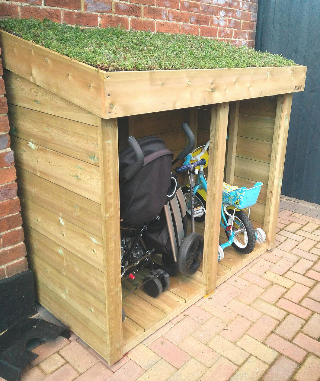 General garden storage unit with green roof living planter, to store tools, prams, logs, bikes and toys