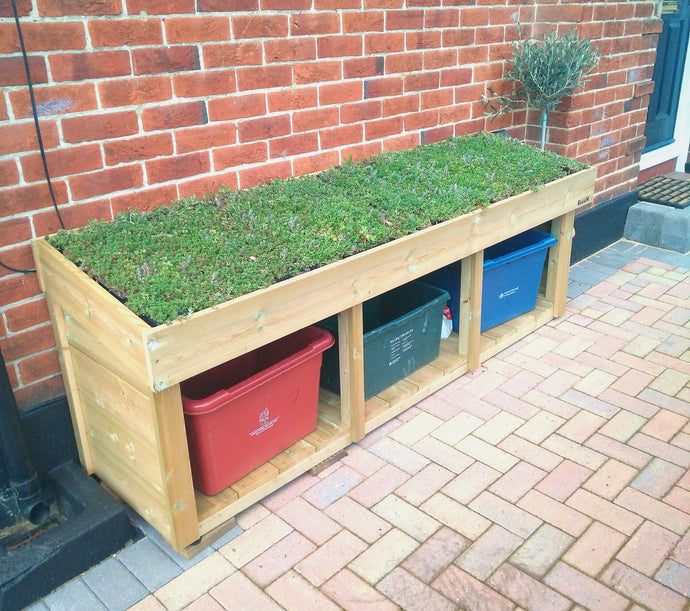 Triple recycling bin box outside external storage shown with sedum green roof