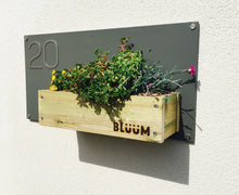 Curb appeal with a Bluum house sign, beautiful fixings, plants and your house number