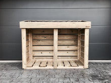 Sturdy high quality firewood log storage unit for your garden with a living green roof planter