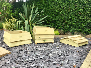 Stackable garden composting bin, made to look like a beehive. An attractive composter
