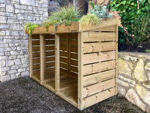 Hand made wheelie bin storage unit with living green roof planter top.  Pressure treated wood and exterior grade fixings for a long life in your garden