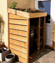 Wheelie bin store with recycling box shelves and living roof planting area