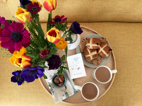 Hot cross buns and tea and flowers