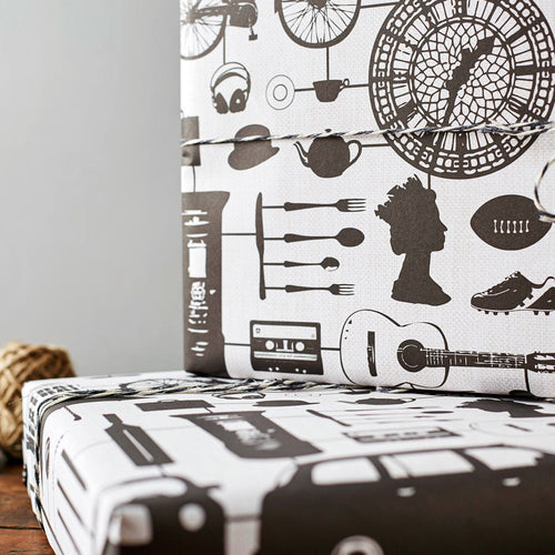 Gift wrap featuring repeating black and white design with iconic London landmarks, Gift wrap featuring iconic London landmarks and symbols, Black and white gift wrap featuring the British flag and double decker bus, Gift wrap featuring hand illustrated repeating London pattern