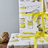 Gift wrap featuring repeating pattern of yellow kitchen and baking items, Yellow gift wrap featuring various baking and cooking tools, Gift wrap featuring various baking items in the colors yellow and charcoal