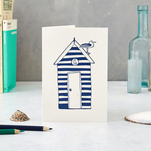 Greeting card featuring striped beach hut and seagull design, Greeting card featuring navy and white beach hut and seagull design, Nautical greeting card featuring beach hut design in navy and white