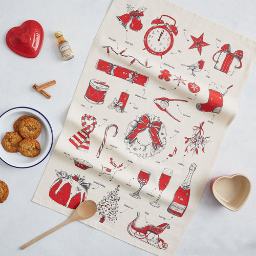 Christmas tea towel featuring repeating charcoal and red traditional Christmas icons, Christmas dish towel featuring iconic Christmas designs, Hand illustrated Christmas designs printed on a cotton tea towel, Christmas kitchen towel featuring Santa's sleigh and stockings, Christmas dish towel featuring mistletoe and Christmas lights