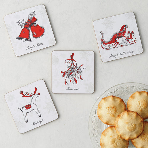 Set of four Christmas coasters with cork backing, Christmas coasters with Santa's sleigh and a reindeer, Christmas coasters with hand illustrated designs, Red and charcoal Christmas coaster set, Christmas coasters gift set, Christmas coasters with bells and mistletoe design