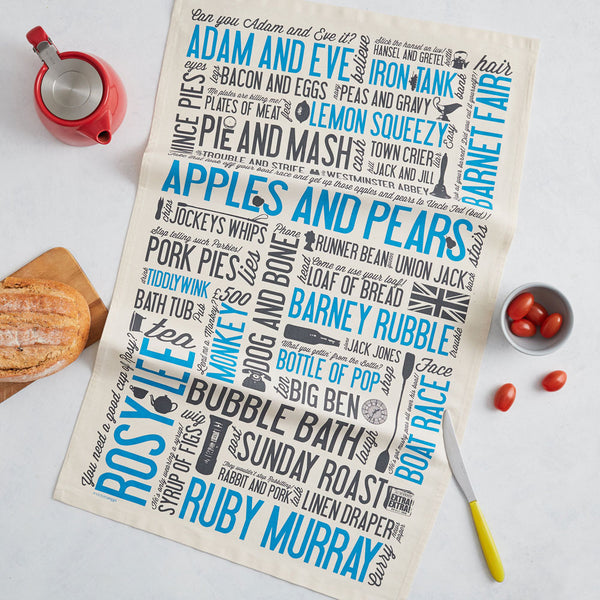 Tea towel with repeating written design of cockney phrases, Tea towel in charcoal and blue cockney slang, Kitchen towel featuring cockney slang, Dish towel featuring written design of cockney slang, Dish towel featuring iconic East London slang