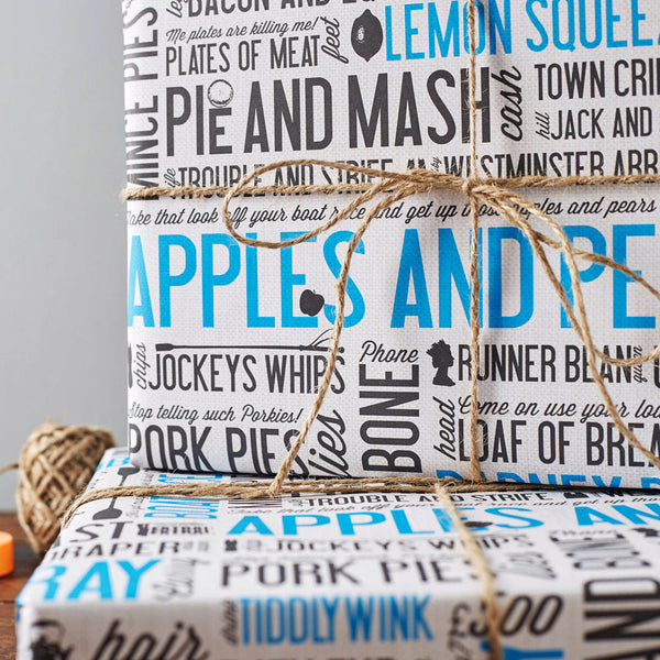Gift wrap featuring repeating traditional east London phrases, Gift wrap with iconic phrases and sayings from East London, Blue and charcoal gift wrap featuring East London phrases, Blue and charcoal cockney gift wrap, Gift wrap featuring charcoal and blue cockney design