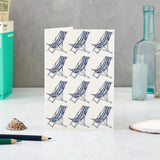 Greeting card featuring repeating beach chair design in navy and white, Navy and white beach chair greeting card, Greeting card featuring repeating beach chair design