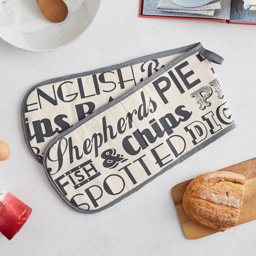 Charcoal colored double oven glove featuring repeating design of traditional English meals, Double oven glove with typography of English meals, Oven glove decorated with traditional English meal design