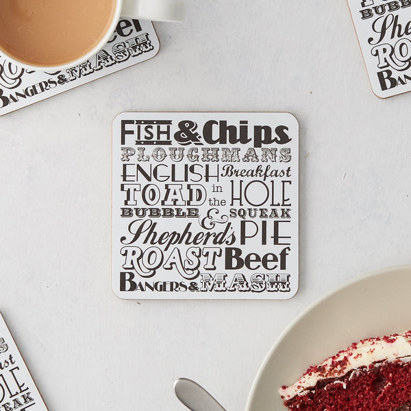 Set of four coasters featuring repeating pattern of traditional English meals, Charcoal coasters set featuring traditional English meals, Coaster set featuring grey repeating design with English meals, Traditional English meal coasters set in charcoal