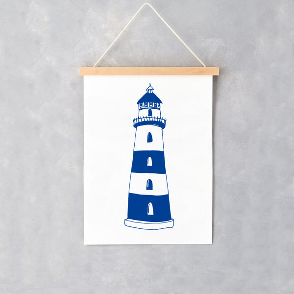Wall print featuring navy and white lighthouse design, Lighthouse design wall print in navy and white, Nautical lighthouse design wall print in navy and white stripes