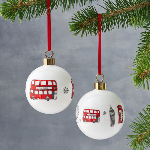 Set of two London icons Christmas ornaments, Christmas ornaments with London Bus and London skyline, Ornaments details with red hand illustrated London landmarks, Christmas bauble with The London Eye and London Bus