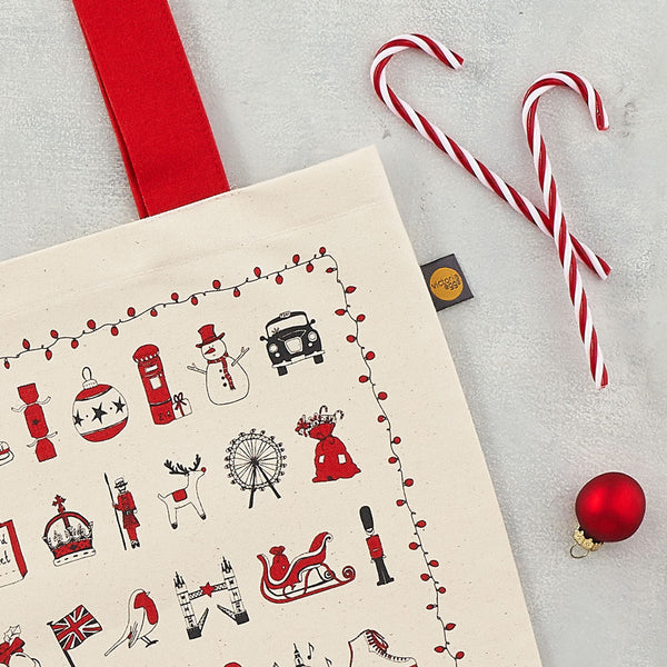 London Christmas icons Canvas shopper bag, London bus, big ben, Oxo Tower, father christmas, snowman, royal albert hall, stocking, post box, taxi, telephone box, hand made in Britain, Victoria eggs,