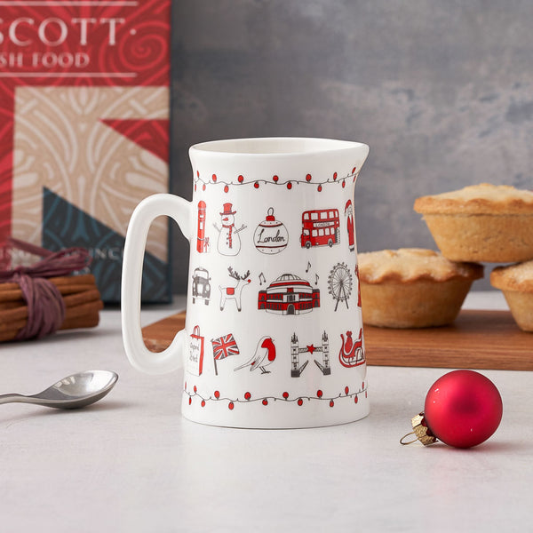 Fine bone china jug featuring iconic London Christmas landmarks, Fine china Christmas jug featuring London landmarks, Jug with repeating Christmas designs from London, Christmas kitchen jug with hand illustrated London icons, Kitchen jug with Tower Bridge and Oxo Tower, Red and charcoal designed kitchen jug for Christmas