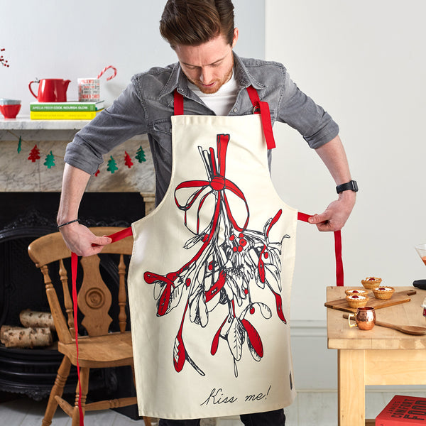 Christmas apron with mistletoe design, Kiss me Christmas apron, Unisex Christmas mistletoe apron with red strap, Men's Christmas apron with mistletoe, Women's Christmas mistletoe apron, Red and charcoal mistletoe Christmas apron, Christmas kitchen apron w
