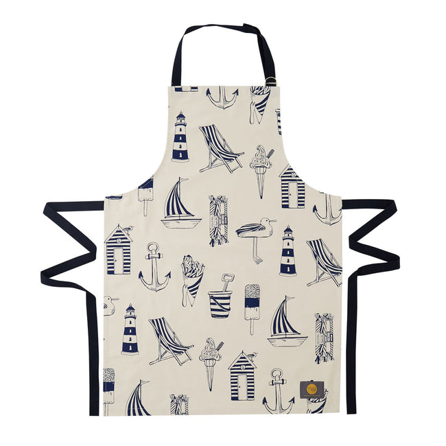 Kitchen apron featuring repeating design of navy nautical icons, Women's nautical apron featuring repeating navy design with beach chairs and sailboats, Men's nautical apron featuring repeating beach design in navy